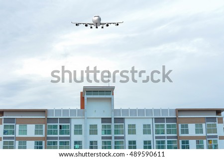 Building against with aircraft on the sky