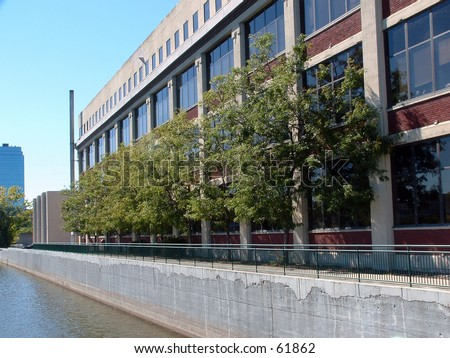 building along the river - stock photo