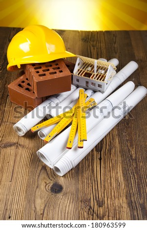 Building and construction equipment on blueprints - stock photo