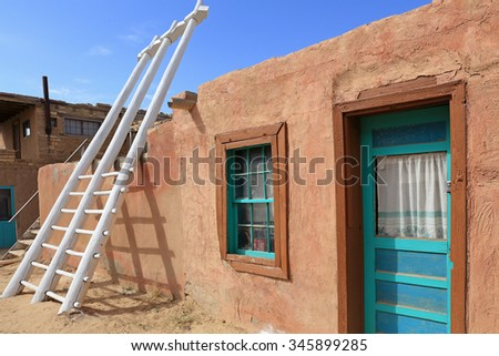 Building and ladder at the Acoma Pueblo in New Mexico. - stock photo