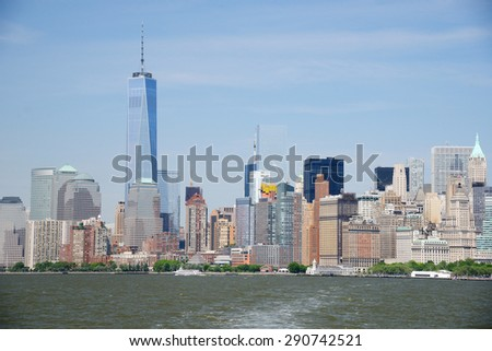 building and skyline of downtown manhattan during daytime as seen from a boat - stock photo