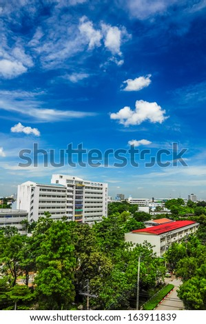 Building and trees in city - stock photo