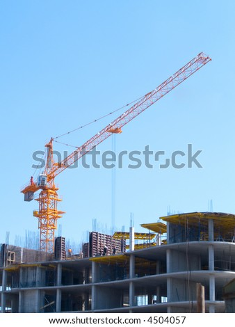 Building construction crane in the blue sky