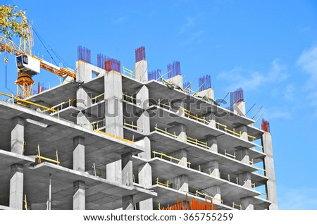 Building construction site against blue sky - stock photo
