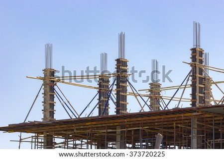 Building construction site against blue sky