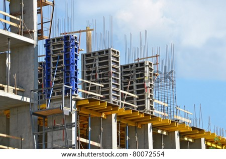 Building  construction site against blue sky - stock photo