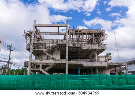 Building construction site in progress against blue sky. - stock photo