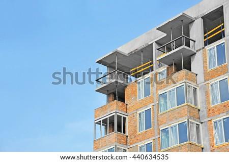 Building construction site work against blue sky - stock photo