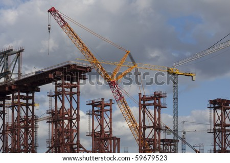 Building construction with cranes - stock photo