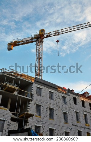 Building construction with tower crane