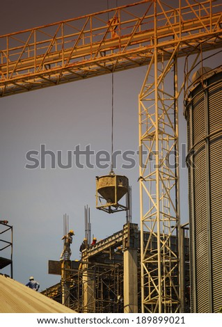 building construction worker working on construction site with heavy tool and building constructure - stock photo