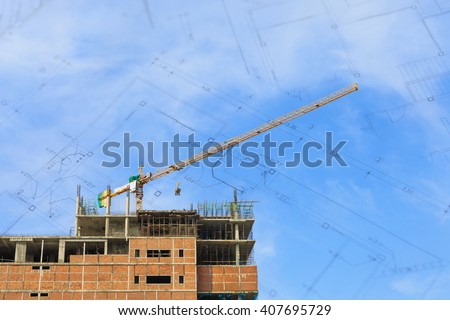 Building crane and construction site under blue sky with drawing background