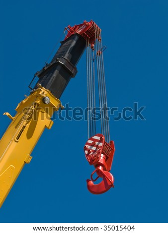 Building crane boom with steel hook - stock photo
