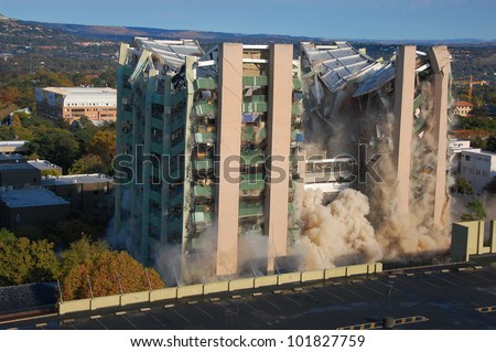 Building demolition by implosion - image 5 of a 10 shot sequence - stock photo