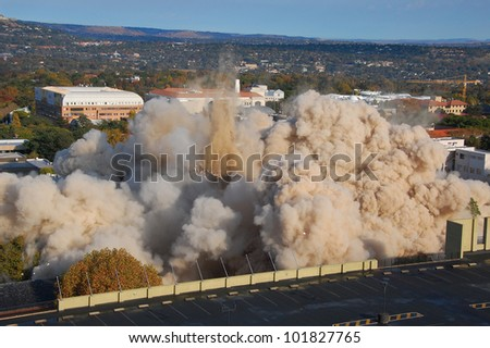 Building demolition by implosion - image 10 of a 10 shot sequence - stock photo