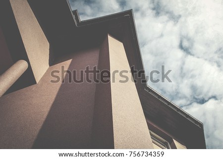 Building detail and cloudy sky