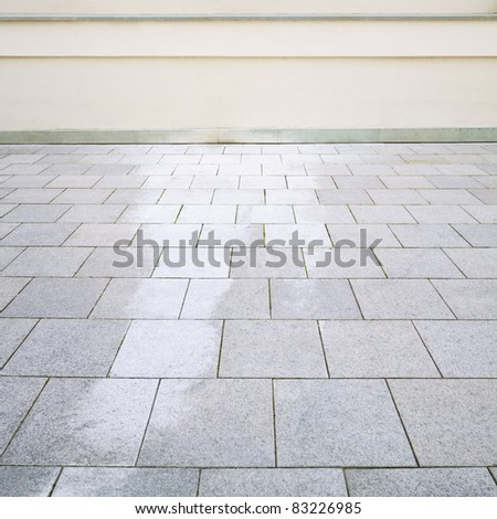 Building exterior detail. Empty wall and floor can be used as background. - stock photo