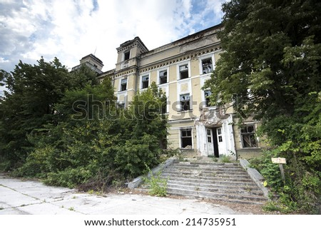 Building exterior partly demolished in war - stock photo