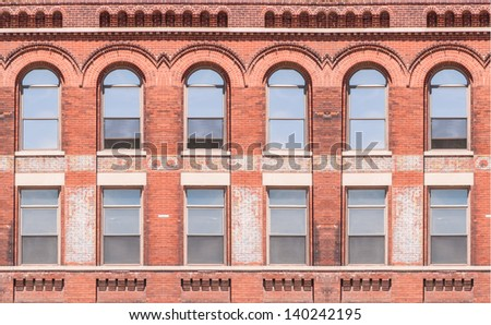 Building exterior with windows of a commercial office building - stock photo