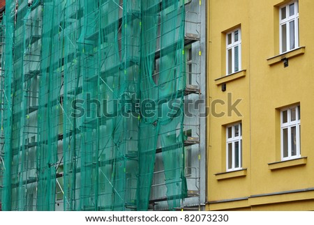 Building facade renovation, house reconstruction, repair. - stock photo