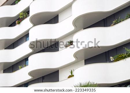 Building facade with balconies - stock photo