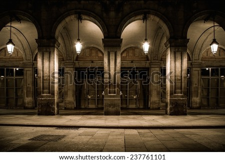 Building facade with columns and lanterns - stock photo