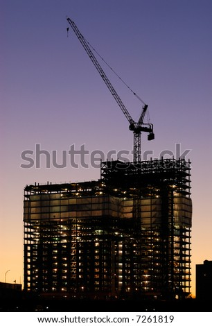 Building frame lit by reflectors at dusk - stock photo