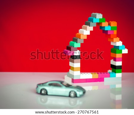 Building house and buying car - stock photo