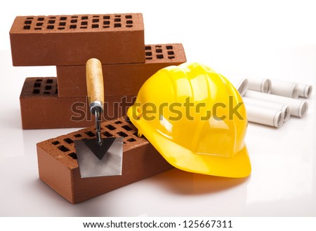 Building house, trowel and bricks - stock photo
