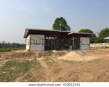 Building house under construction. New House Concepts. - stock photo
