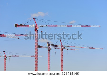 Building houses a variety of cranes - stock photo
