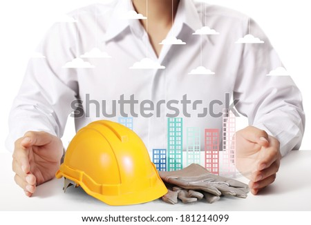 Building in a hand businessmen  - stock photo