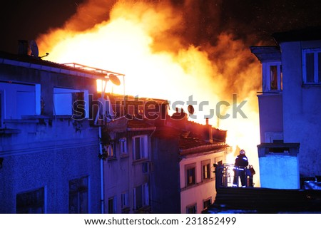 Building in a inferno of flames - stock photo