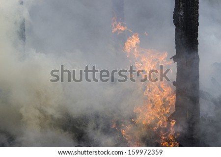 building in full flaming - stock photo