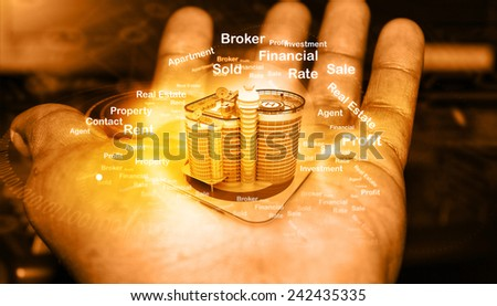 Building  in human hands, real estate concept - stock photo