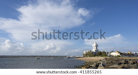 building lighthouse in Isla Cristina, Huelva, Spain in front Punta del Moral village, near beaches of Ayamonte