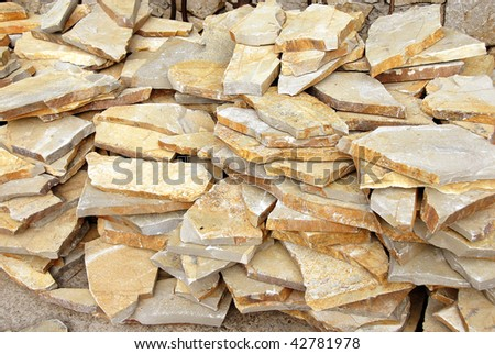building materials, natural flagstones on stack outdoor - stock photo