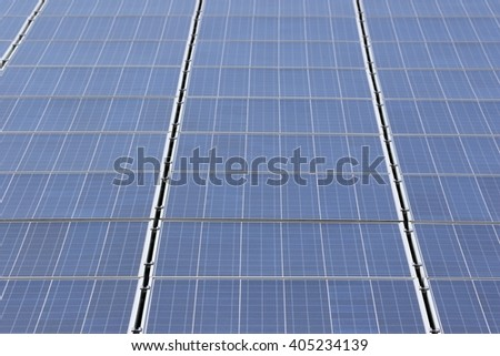 building-mounted photovoltaic solar collectors - stock photo
