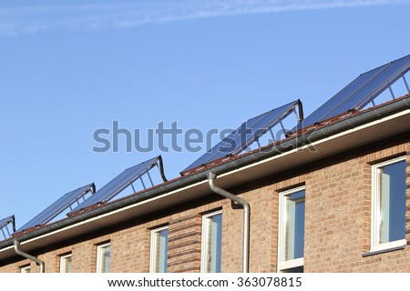 building-mounted solar thermal collectors - stock photo