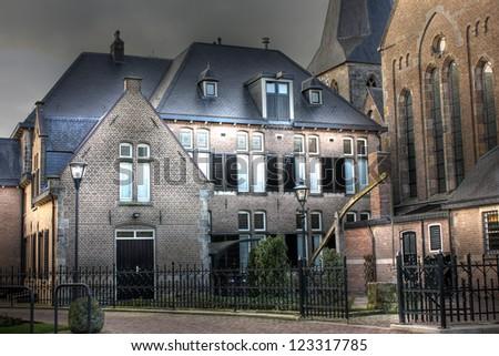 Building near Church, Denekamp - The Netherlands - stock photo
