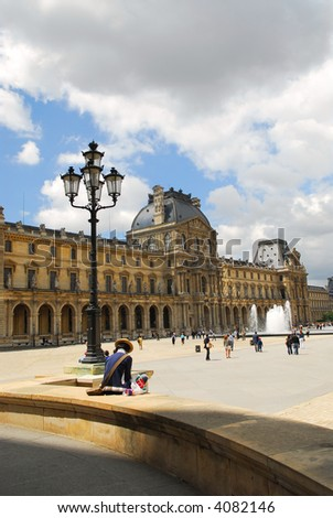 Building of Louvre museum on summer day in Paris, France
