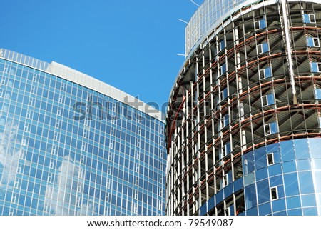 building of new office center on blue sky background - stock photo