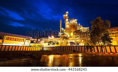 Building of powerhouse and pipe system on night scene - stock photo