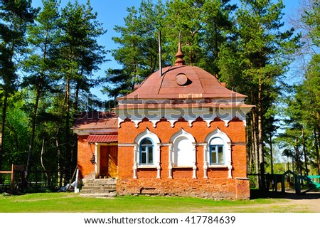 Building of red brick, built in the 19th century to the cells of the monks hermits. Peryn Skete in Veliky Novgorod, Russia. Architecture spring landscape.  - stock photo