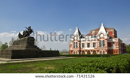 Building of the Drama Theatre, built in traditional Russian style and monument to the cavalry. Urban landscape. Russia, Samara. - stock photo