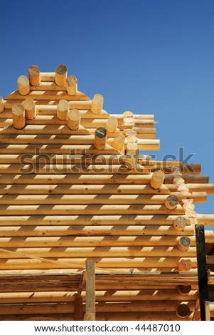 Building of the new log house - stock photo