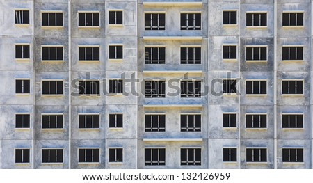 Building pattern build from precast panel for background concept. - stock photo