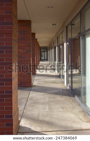 Building pillars outside corridor and glass doors.