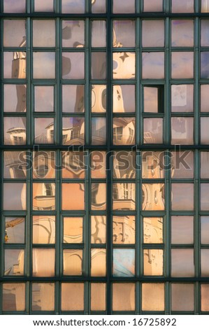 Building reflecting in modern office glassy windows
