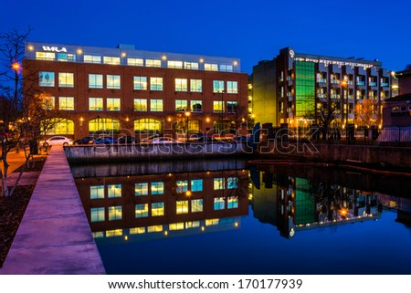 Building reflecting in the water at night in Baltimore, Maryland. - stock photo